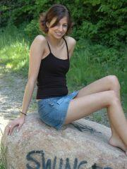 Pictures of Alyssa Doll on a huge rock