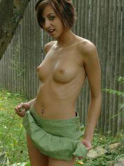 Pictures of Alyssa Doll exposing her small tits outside
