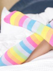 Pictures of teen Autumn Riley teasing in striped socks