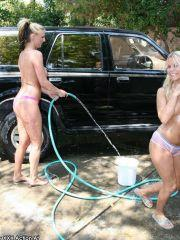 Pictures of two hot coeds washing a car