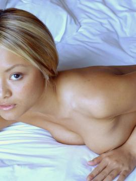 Tila Tequila gets naked and invites you to play with her in bed