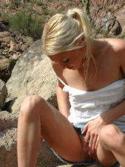 Pictures of Dream Kelly rubbing her pussy outside