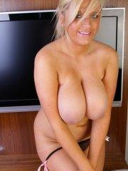 Pictures of Ellie Jay showing her massive jugs