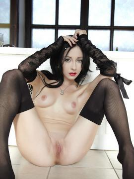 Pictures of a sexy brunette girl spreading her legs
