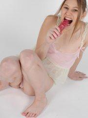 Pictures of teen Harmony 18 playing with a vibrator