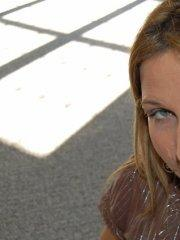 Pictures of Kelly Anderson on her knees sucking cock