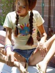 Pictures of teen Kona Kalani teasing in pigtails and short shorts