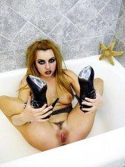 Pictures of Lexi Belle spreading her legs in the bathroom