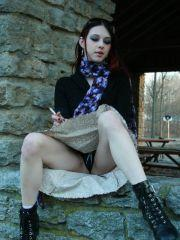 Pictures of Liz Vicious smoking a cigarette outside