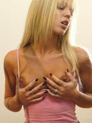 Pictures of Naughty Belle masturbating her tight pussy