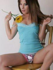 Pictures of teen cutie Nicole Sparks teasing with a dress and flowers