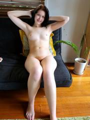 Brunette coed Lulu Reynolds exposes her nude body at home