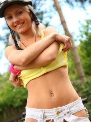 Pictures of teen chick Pinky June getting hot outside