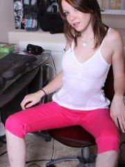 Pictures of teen cutie Riley Rebel stripping in the office
