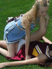 Pictures of two teen cheerleaders practicing their moves outside