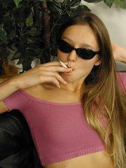 Pictures of teen amateur Sweet Dominique smoking a cigarette