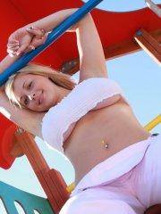Pictures of teen chick Tegan Brady teasing at a park