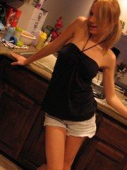 Pictures of teen girl Tiffany Lovelle being naughty in the kitchen