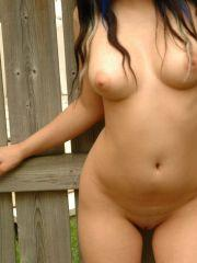 Pictures of Angel Button getting naked in the back yard